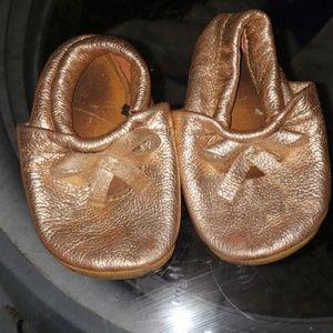 Gold moccasins size 6 toddler